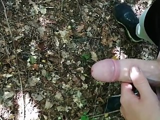 Sissy peeing and cumming in the forest
