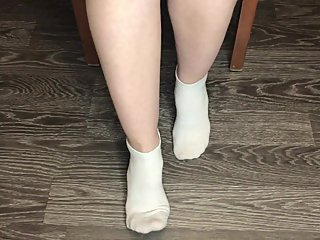 STUDENT GIRL SHOWS WHITE SOCKS AND FEET AFTER STUDYING.