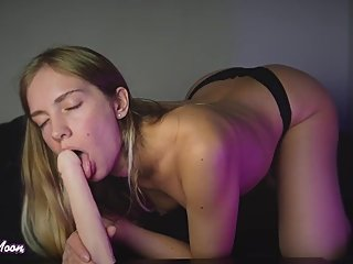 Sucking dildo in doggystyle