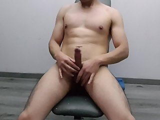 Slim twink masturbates in front of the camera and cums over